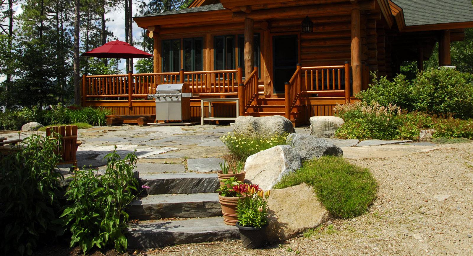 Denmark lake house gnome landscape design masonry for Log home landscape design